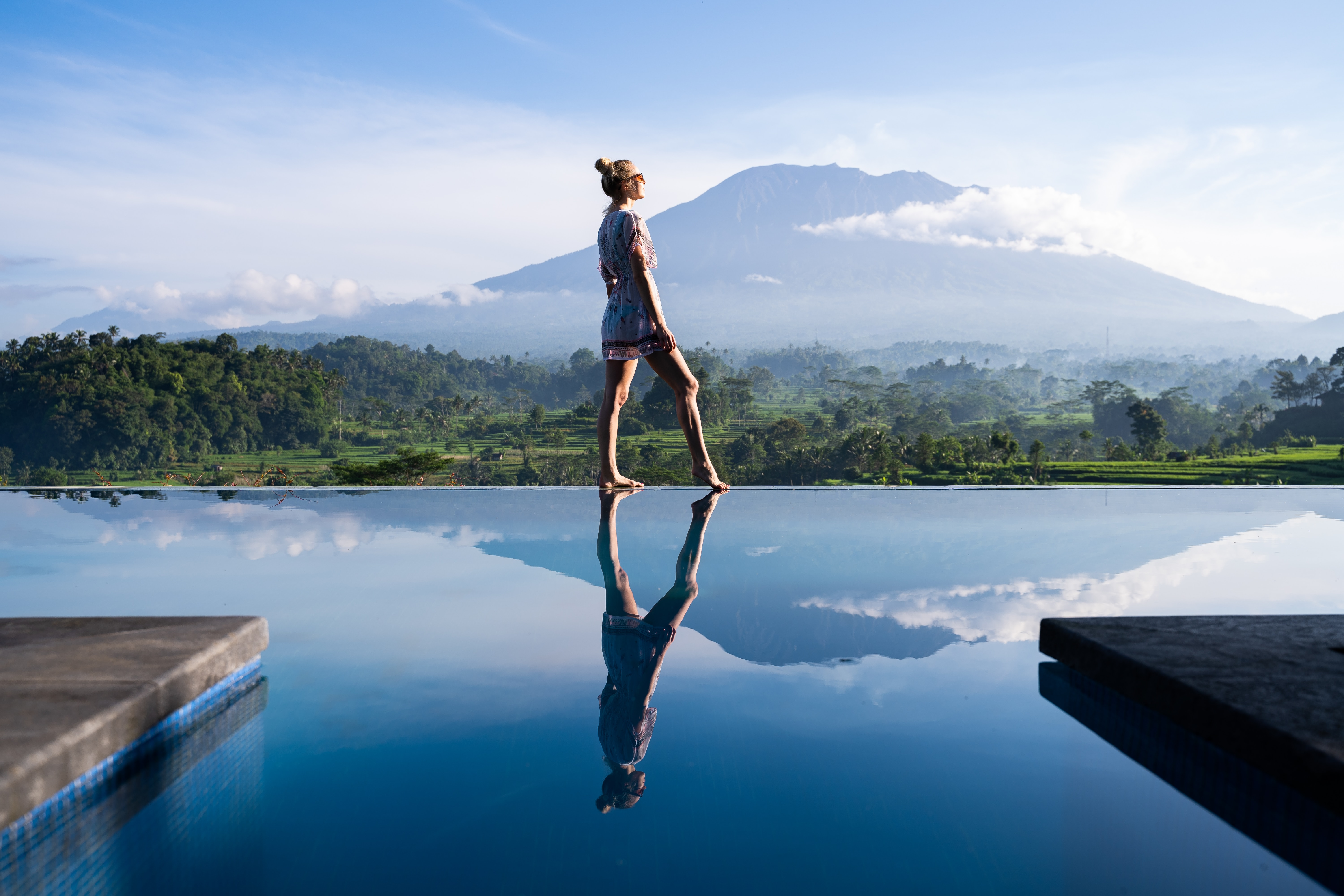A woman standing in front of Mount Agung, Sidemen, Bali, Indonesia